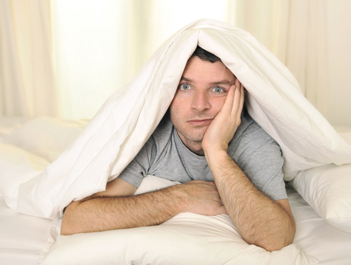 sleeplessness in recovery and sobriety - man with insomnia in bed - mountain laurel recovery center