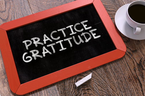 Practicing Gratitude in Recovery - practice gratitude written on a board
