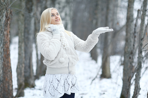 Weathering Recovery During Winter - girl in a snowy forest