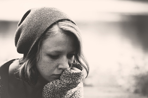 5-Common-Mental-Health-Disorders-Diagnosed-with-Addiction - b and w photo girl in stocking cap sad