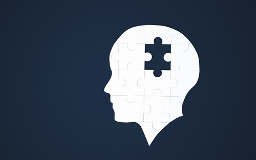 dark blue background with white puzzle in shape of human head - missing piece in middle - blackouts